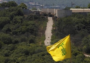 An Israeli military outpost as seen from South Lebanon, where a Hezbollah flag flutters